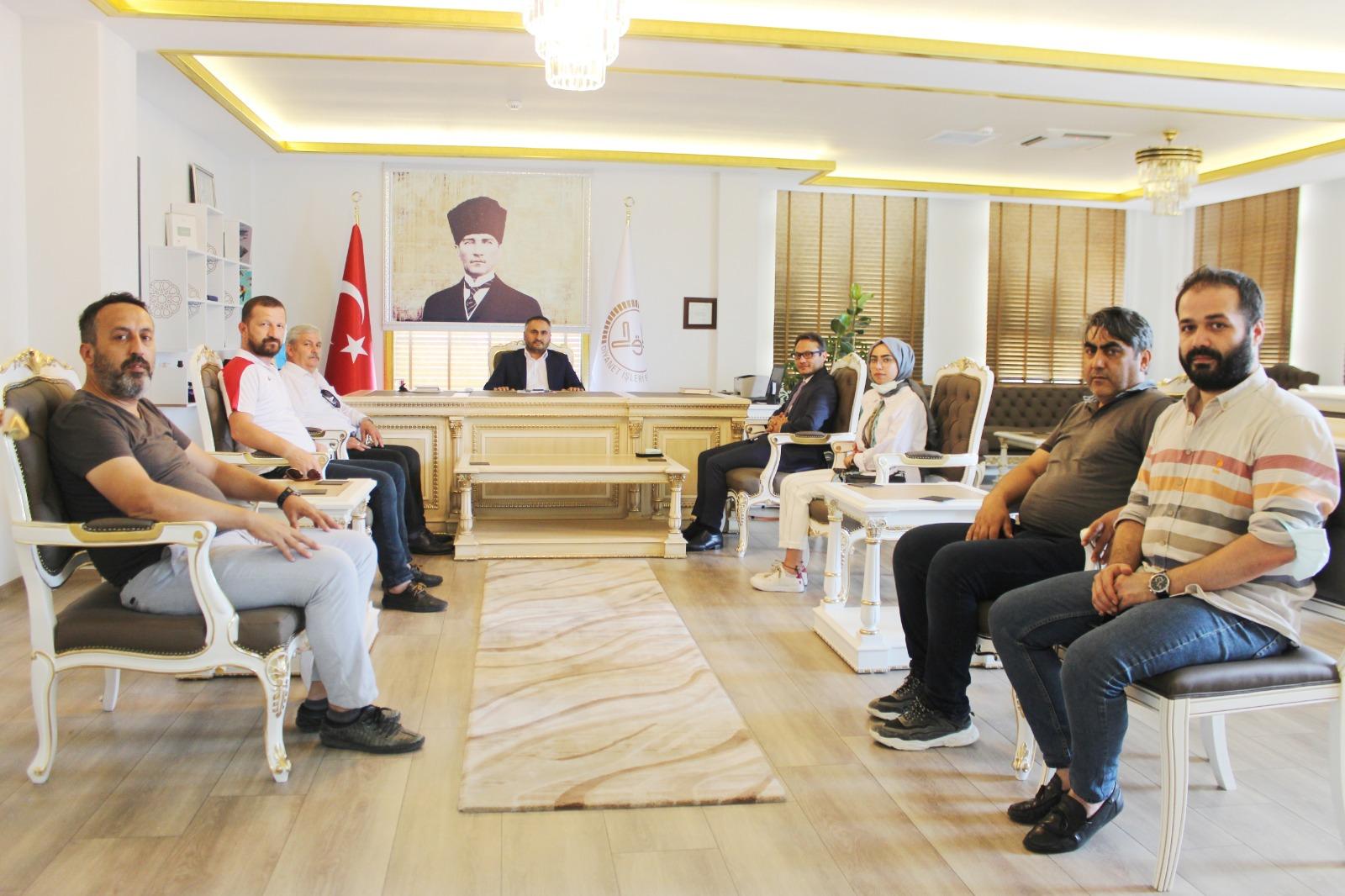 MHP'den Müftü Okuş'a ziyaret